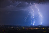 Night lightning strike of 2016 in Vipolže (Slovenia - Europe). Rare cloud ground lightning from super cell in west Slovenia near border with Italy in Friuli Venezia Giulia region (Lucinico, Mossa, Cap