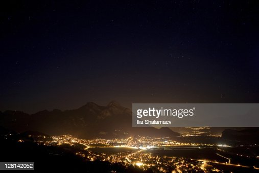 Night sky over Rhein valley that separates Liechtenstein and Switzerland : Bildbanksbilder
