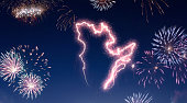 A dark night sky with a sparkling red firecracker in the shape of Quebec composed into.(series)