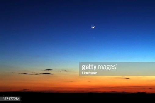 Night skyline with moon in the distance