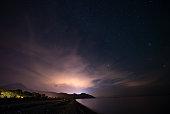 Starry sky at night at the sea coast in Cirali, Turkey - landscape exterior