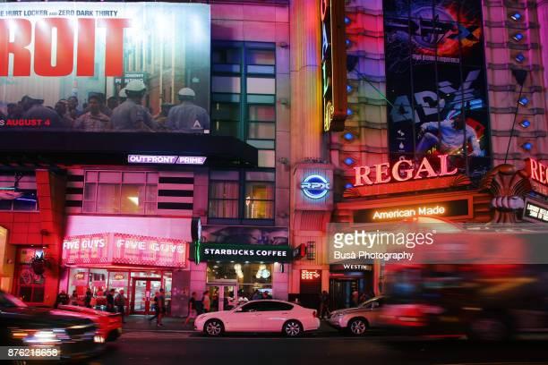 Night street scene in Midtown Manhattan: facade of Regal Movie Theaters at 42nd Street. New York City, USA