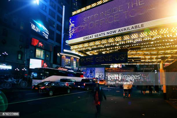 Night street scene in Midtown Manhattan: marquee of the famous New Amsterdam Theatre at 42nd Street. New York City, USA