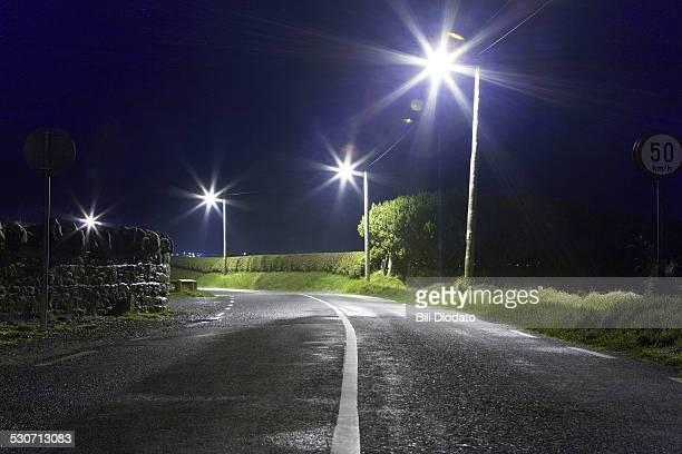 Night street with lit lightposts