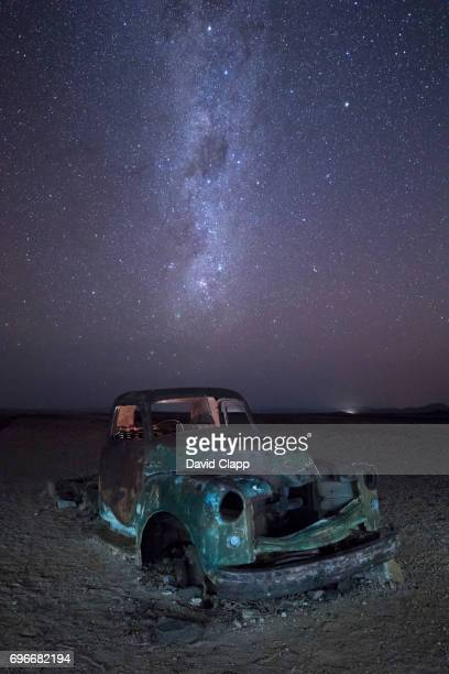 Night time image of Milky Way over truck in Namibia