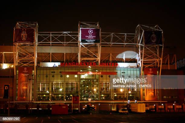 A night time shot of Manchester United's Old Trafford stadium at 2am ready for the UEFA Champions League Final decorated in UCL logos
