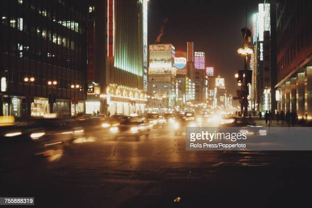 Night time view of cars and traffic on the streets in the centre of the city of Sapporo on the island of Hokkaido in Japan in January 1972 Sapporo is...