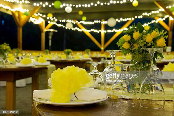 Night time wedding with yellow flowers and strings of light