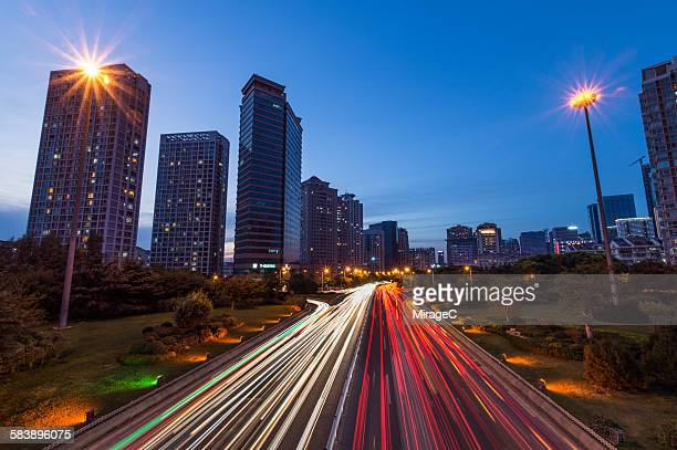 Night traffic car light trails in Qingdao downtown