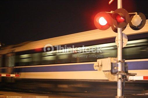 Night Train Passes Railway Crossing Stock Photo   Thinkstock