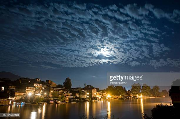A night view of houses submerged in flooded water on the bank the Jehlum River on May 29 2010 in Srinagar Kashmir India Atleast four people have been...