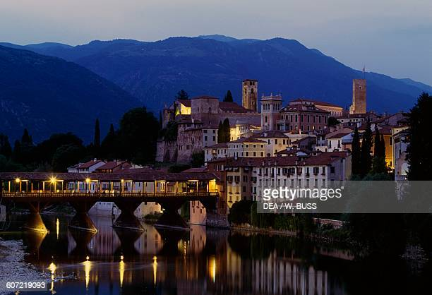 Night view of Ponte Vecchio or Ponte degli Alpini over the Brenta river designed by Andrea Palladio in 1569 Bassano del Grappa Veneto Italy