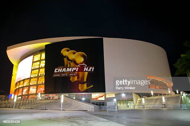 Night view of round American Airlines Arena