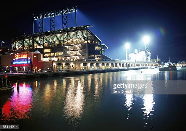Night view of SBC Park from McCovey Cove as the stadium lights reflect on the water during a game between the Washington Nationals and the San...