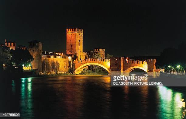 Night view of Scaliger or Castel Vecchio bridge over the Adige River 13541356 Verona Veneto Italy