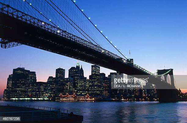 Night view of the Brooklyn Bridge on the East River and Lower Manhattan with the Twin Towers of the World Trade Center 20th century Manhattan New...