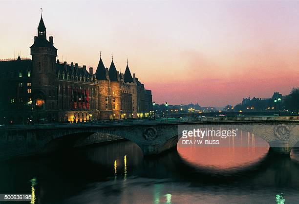 Night view of the Conciergerie Paris IledeFrance France