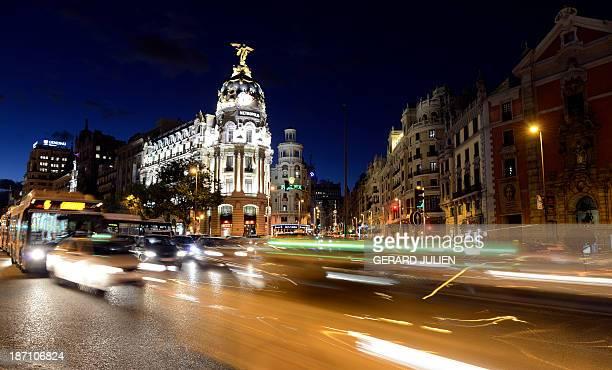 Night view of the Metropolis Building from Gran Via in Madrid on November 5 2013 AFP PHOTO / GERARD JULIEN