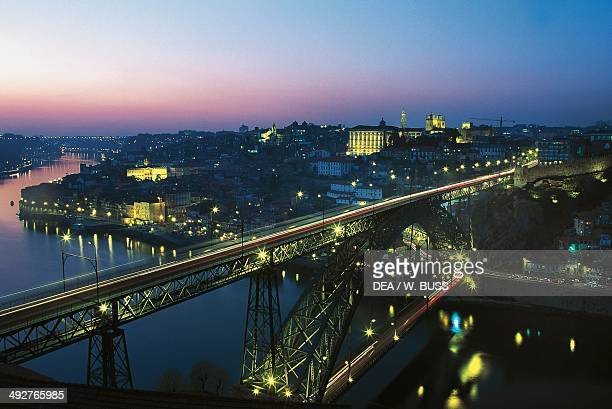Night view of the old city with the Dom Luis I Bridge over the Douro River historic centre of Porto Portugal