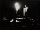 Night view of the photographer's Opel race car at a gas station 1930