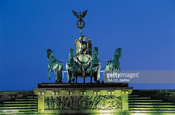 Night view of the Quadriga by Johann Gottfried Schadow on top of the Brandenburg Gate Berlin Germany Night view