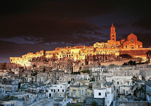 Night view of the Sasso Barisano cave dwelling with Matera Cathedral historic center of Matera Basilicata Italy