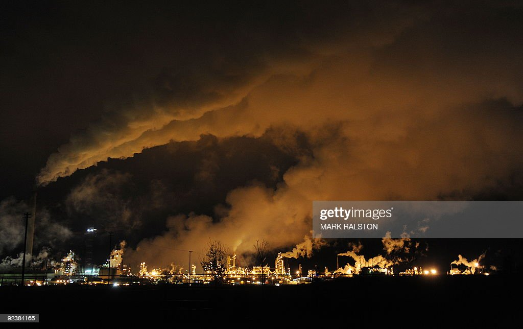 A night view of the Syncrude oil sands extraction facility near the town of Fort McMurray in Alberta Province, Canada on October 22, 2009. Greenpeace is calling for an end to oil sands mining in the region due to their greenhouse gas emissions and have recently staged sit-ins which briefly halted production at several mines. At an estimated 175 billion barrels, Alberta's oil sands are the second largest oil reserve in the world behind Saudi Arabia, but they were neglected for years, except by local companies, because of high extraction costs. Since 2000, skyrocketing crude oil prices and improved extraction methods have made exploitation more economical, and have lured several multinational oil companies to mine the sands. AFP PHOTO/Mark RALSTON