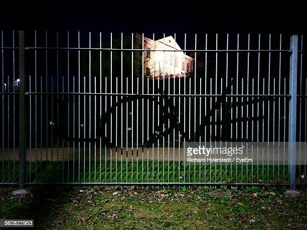 Night View Of Word Love Painted On Fence