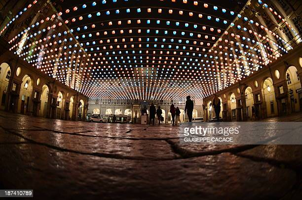 A night view 'Palazzo di Città' at a square lit by a creation of Daniel Buren Tappeto volante as part of 'Luci d'artista' in Turin on November 08...