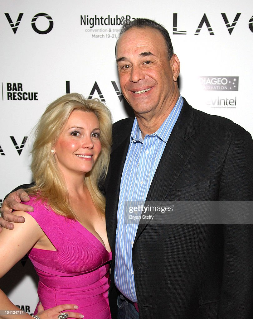Nightclub & Bar Media Group President and host and Co-Executive Producer of the Spike television show 'Bar Rescue' Jon Taffer (R) and his wife Nicole Taffer appear during a 'Bar Rescue' happy hour event at the Lavo Restaurant & Nightclub at The Palazzo Las Vegas during the 28th annual Nightclub & Bar Convention and Trade Show on March 19, 2013 in Las Vegas, Nevada.