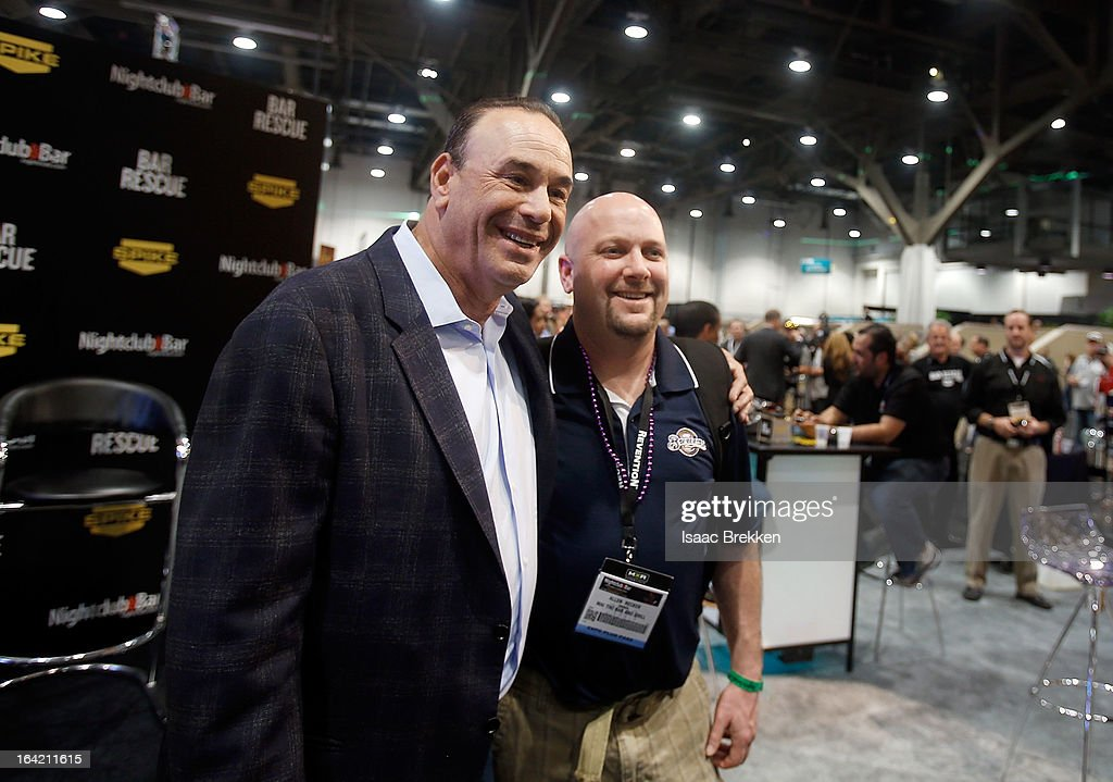 Nightclub & Bar Media Group President and host and Co-Executive Producer of the Spike television show 'Bar Rescue' Jon Taffer (L) poses with attendees at the Spike TV booth during the 28th annual Nightclub & Bar Convention and Trade Show at the Las Vegas Convention Center on March 20th, 2013 in Las Vegas, Nevada.