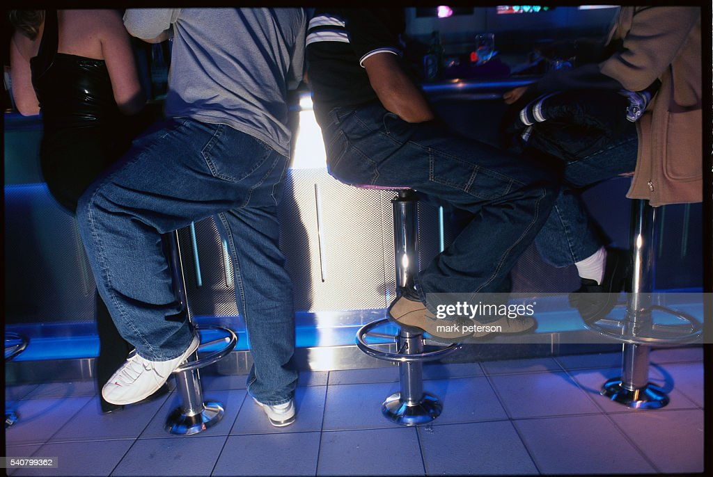 Nightclub goers sit in Bar Code a video arcade bar in Times Square where DJ's play music at night