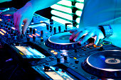 Dj mixes track in nightclub at party