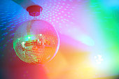 Disco ball in a nightclub with colorful lights.