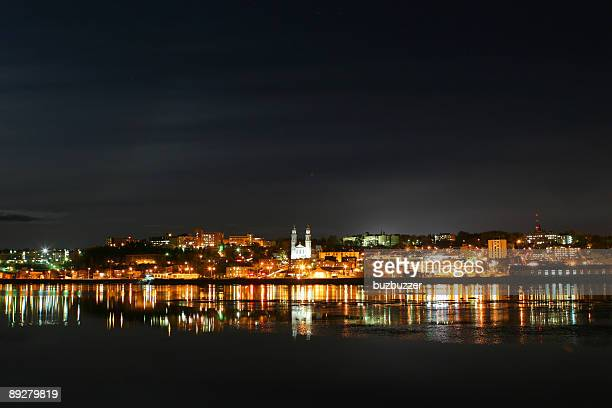 Nightime scene of Chicoutimi city reflection over the Saguenay river