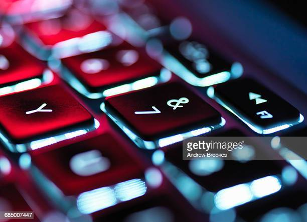 Night-lit laptop computer focusing on the keyboard