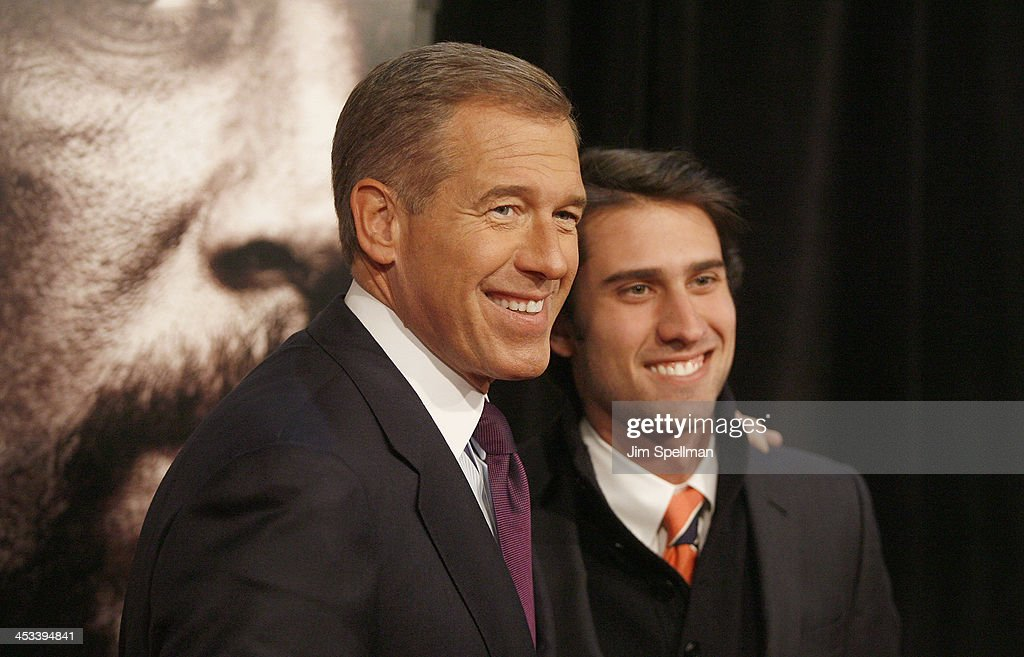 NBC Nightly News Anchor Brian Williams and son Doug Williams attend the 'Lone Survivor' New York premiere at Ziegfeld Theater on December 3, 2013 in New York City.