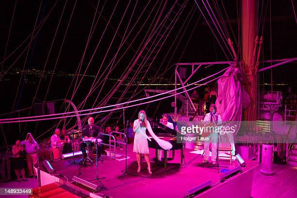 Night-time concert by band 'Dolce Vita' on deck of sailing cruiseship Royal Clipper (Star Clippers Cruises) during Mediterranean Sea voyage.