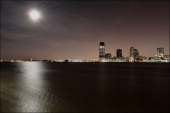 A nighttime moonlit view of the Jersey City skyline New Jersey June 22 2013 The Goldman Sachs Tower can be seen on the left
