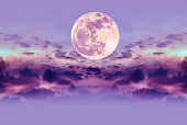 Supermoon on purple nature background. Attractive photo of night sky and silhouette of clouds. Outddor at the nighttime with beautiful full moon. The moon were NOT furnished by NASA.