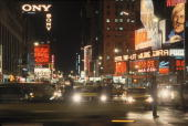 Nighttime view along Broadway near the intersection of West 43rd Street New York New York 1970s