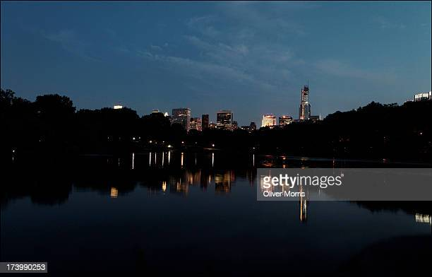 A nighttime view looking south over The Lake in Central Park of the Manhattan skyline with the General Motors Building the Sony Tower the General...