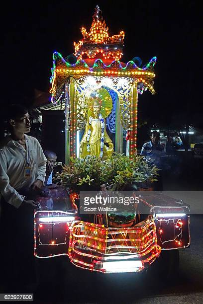 Nighttime view of a Buddhist devotees with an illuminated mobile shrine as they seek donations for a local monastery Pyay Myanmar early to mid2010s