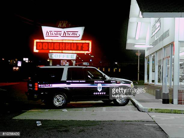 Nighttime view of a Fairfax County police vehicle parked outside a Krispy Kreme donut shop Alexandria Virginia September 13 1998