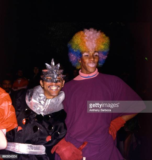 Nighttime view of a pair of men in clown costumes during the annual Halloween Parade New York New York late 1970s or early 1980s