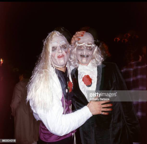 Nighttime view of a pair of participants dressed as an elderly couple during the annual Halloween Parade New York New York late 1970s or early 1980s