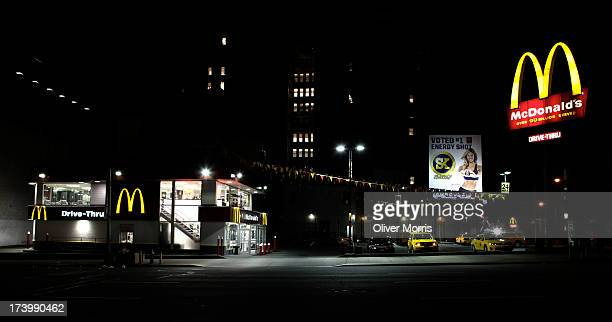 A nighttime view of an 24hour McDonalds restrauant with a drivethru window Midtown West New York May 28 2013