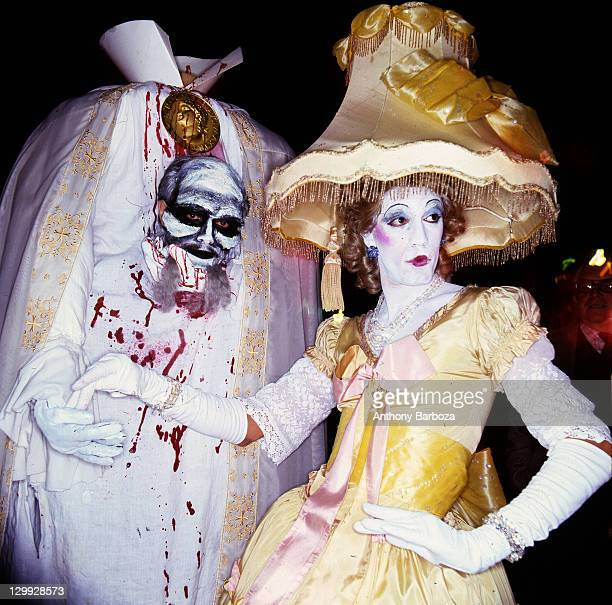 Nighttime view of participants in elaborate costumes during the annual Halloween Parade New York New York late 1970s or early 1980s