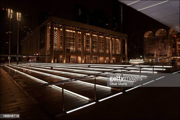 Nighttime view of the Josie Robertson Plaza's Grand Stair outside the David H Koch Theater and the Metropolitan Opera House at the Lincoln Center for...