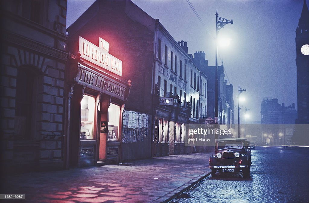 A nighttime view of the Lifeboat Bar in Dublin Eire June 1955 Original publication Picture Post 7808 Dublin pub 18th June 1955